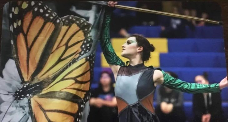 Color guard uses movement with flag that is choreographed with music
