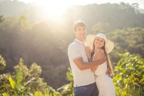 Couple against a green backdrop