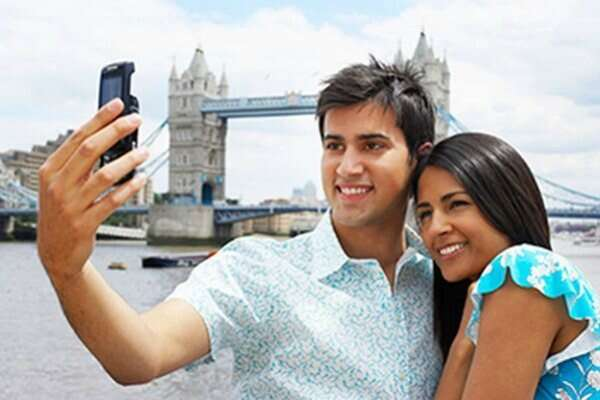 Indian tourist couple clicking a picture in London