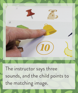 The instructor says three sounds, and the child points to the matching image. (BayTreeBlog.com)