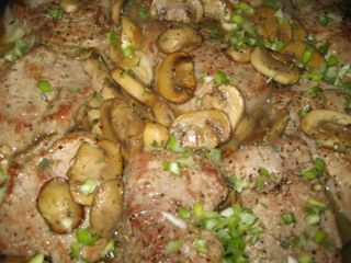 Pork with mushrooms, scallions, herbs, and wine