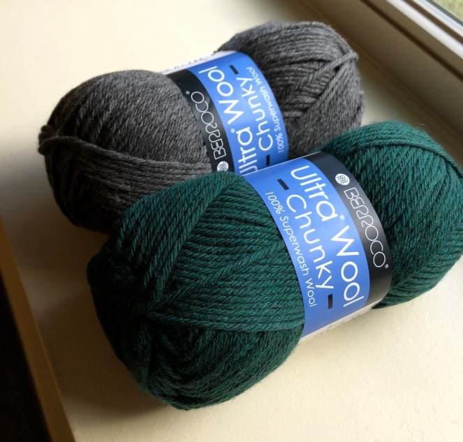 photo of two balls of berroco ultra wool chunky, one in the pine color and one in charcoal