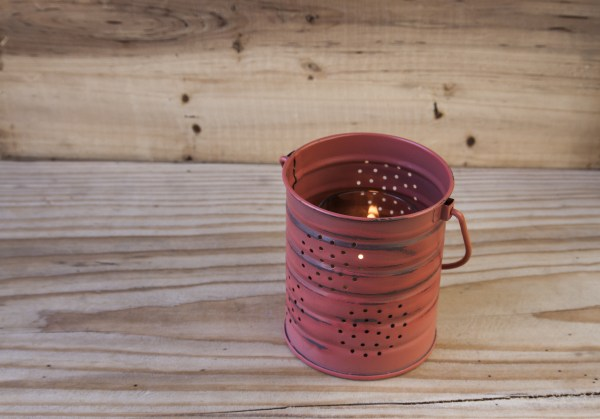Decorative Tin Can Lantern on a Wooden Background.
