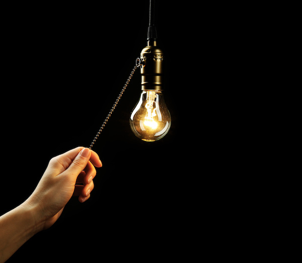 Why does the light bulb turn on?