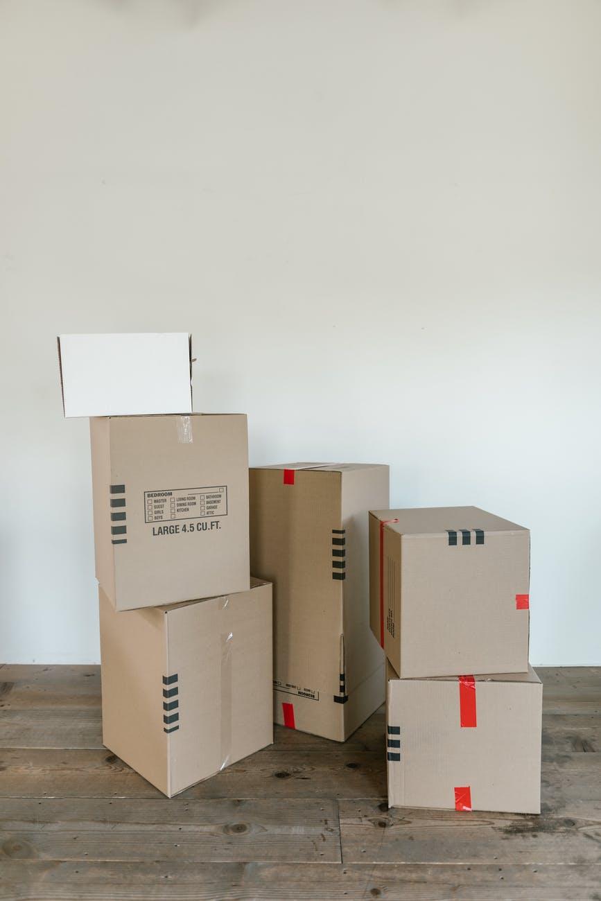 brown cardboard boxes on white floor