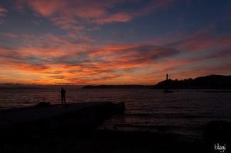 lov ribe, zalazak sunca, uvala Ovčice, Split, Hrvatska