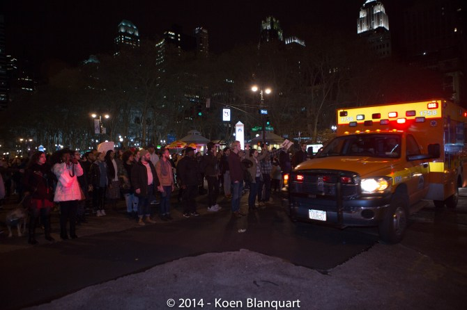 Protesters stopping to allow an ambulance to pass on Sixth Avenue, while they continue chanting