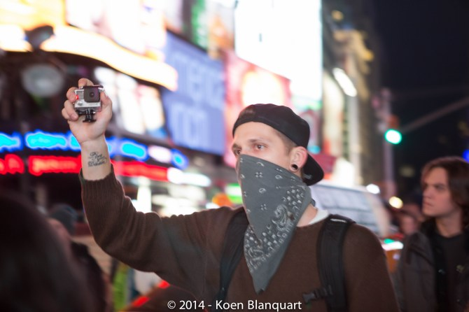 Masked Ferguson protester in Times Square, NYC
