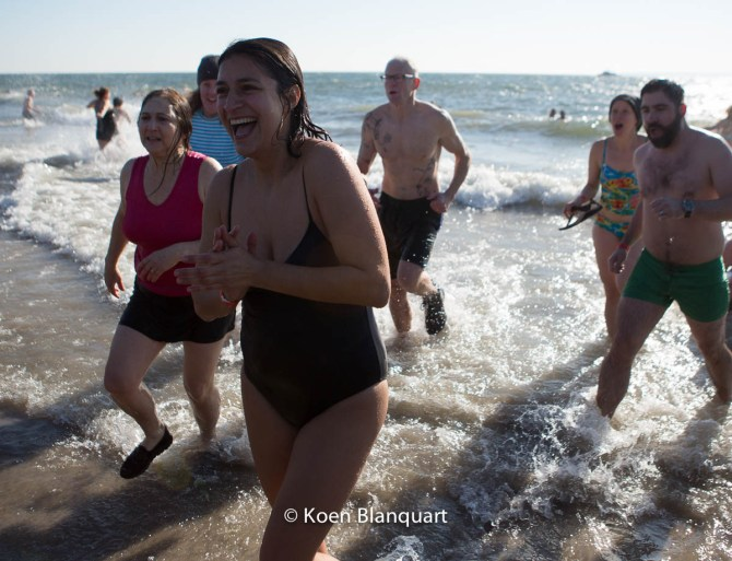 People returning after swimming in icecold water during the Coney Island Polar Bear Plunge 2015