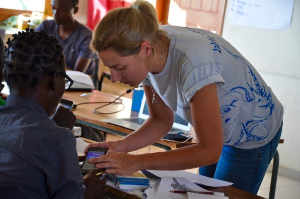Anouk training the technicians in smartphone use