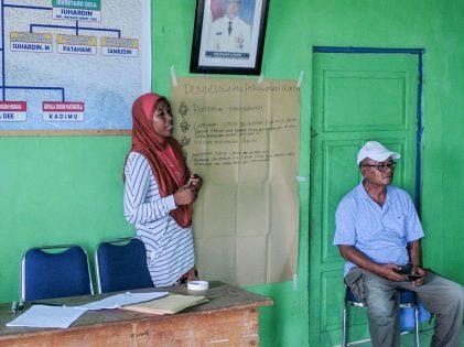 Nusi explaining the timeline of octopus fishery management