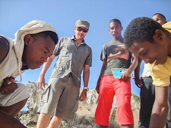Narison (in the red shorts) identifying marine life on the beach | Photo: Feno Hanitriniala