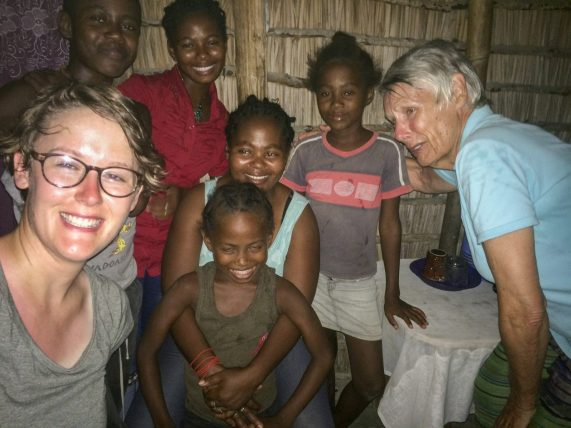 Volunteers Nicole (left) and Lesley (right) with one of their homestay families