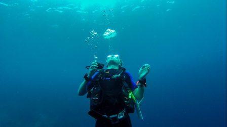 Volunteer Adam blowing bubble rings
