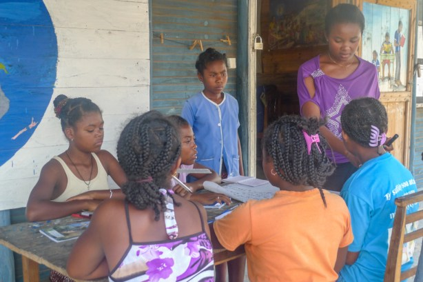 Lucia (purple top on the right) helping out with the Girls Club in 2015.