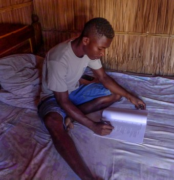 Angelot studying in his new hut!