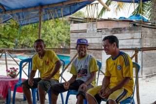 Homestay hosts with Blue Ventures staff in Raja Ampat
