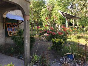 Alda and Alfonso's garden in Beloi Village