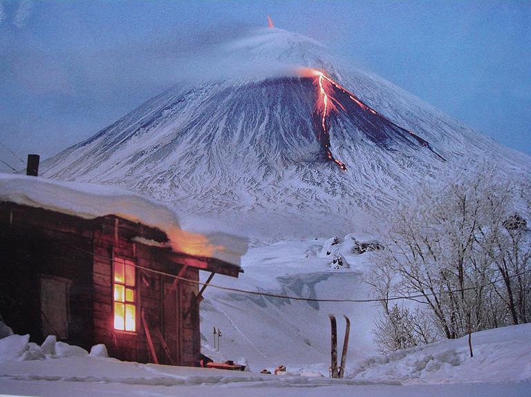 Klyuchevskaya sopka - the highest volcano in Kamchatka. Eruption in the dusk