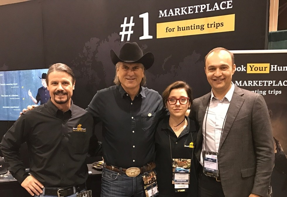 James Reed, Aleksei Agafonov and Jim Shockey - the BookYourHunt.com team at the show booth