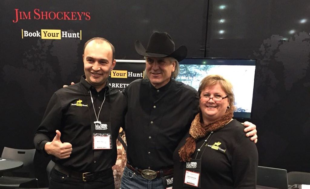 Aleksei Agafonov, Jim Shockey, and Catherine McConnel: the BookYourHunt.com team at the hunting convention