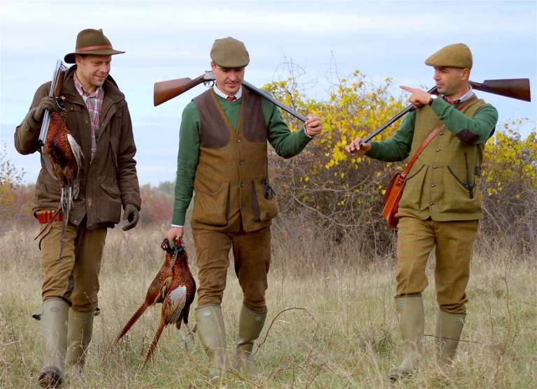 Pheasant hunters in traditional European attire