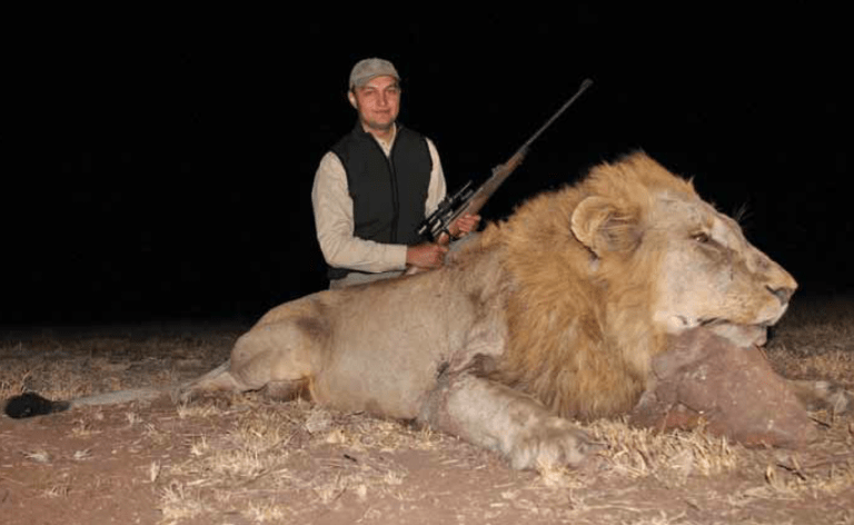 A hunter with a lion that nearly got him