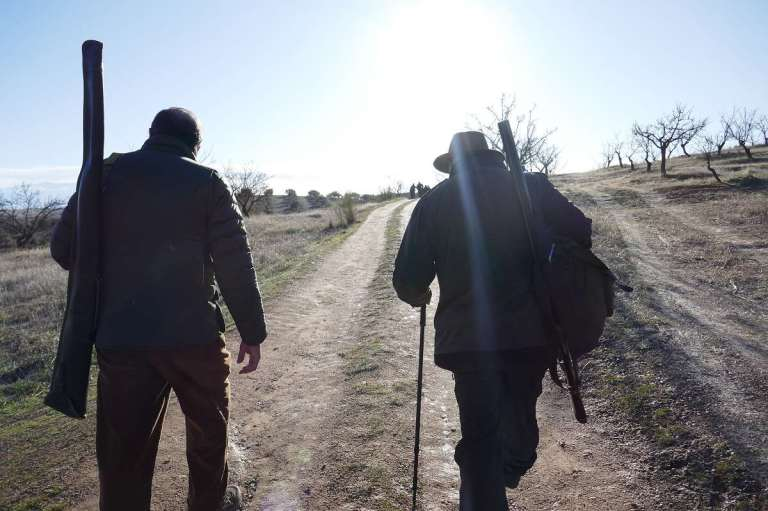 Two hunters on their way to hunt in Spain