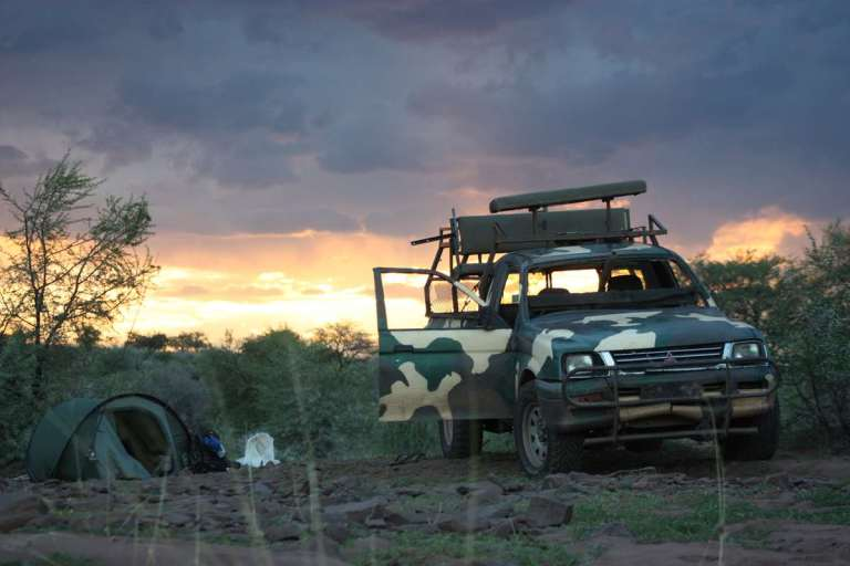 A jeep and a tent in African bush