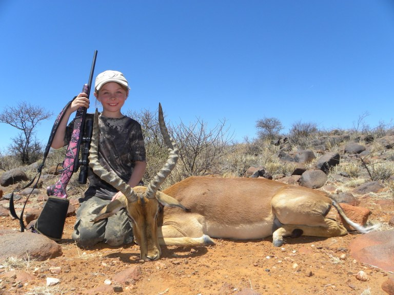 Josie with her impala, taken in an area filled with ancient Bushman rock paintings.