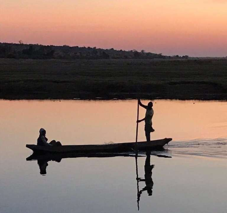 Two Africans in a canoe
