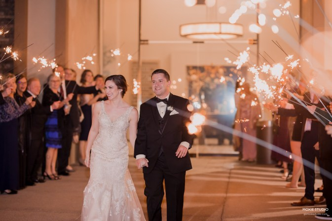 couple walking under sparklers at Paiute