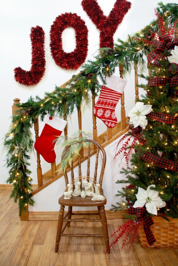 Bronner's Christmas Decorations, Nativity, Stockings, Garland Draped Over Railing, Christmas Tree And Tinsel Letters