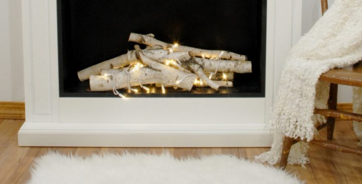 Faux Fireplace With Birch Logs And Christmas Lights