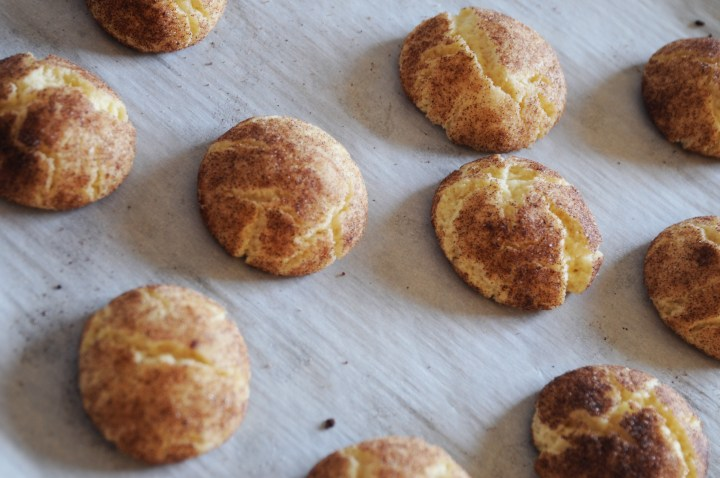Cinnamon and Sugar Snickerdoodle Cookies On Parchment Paper