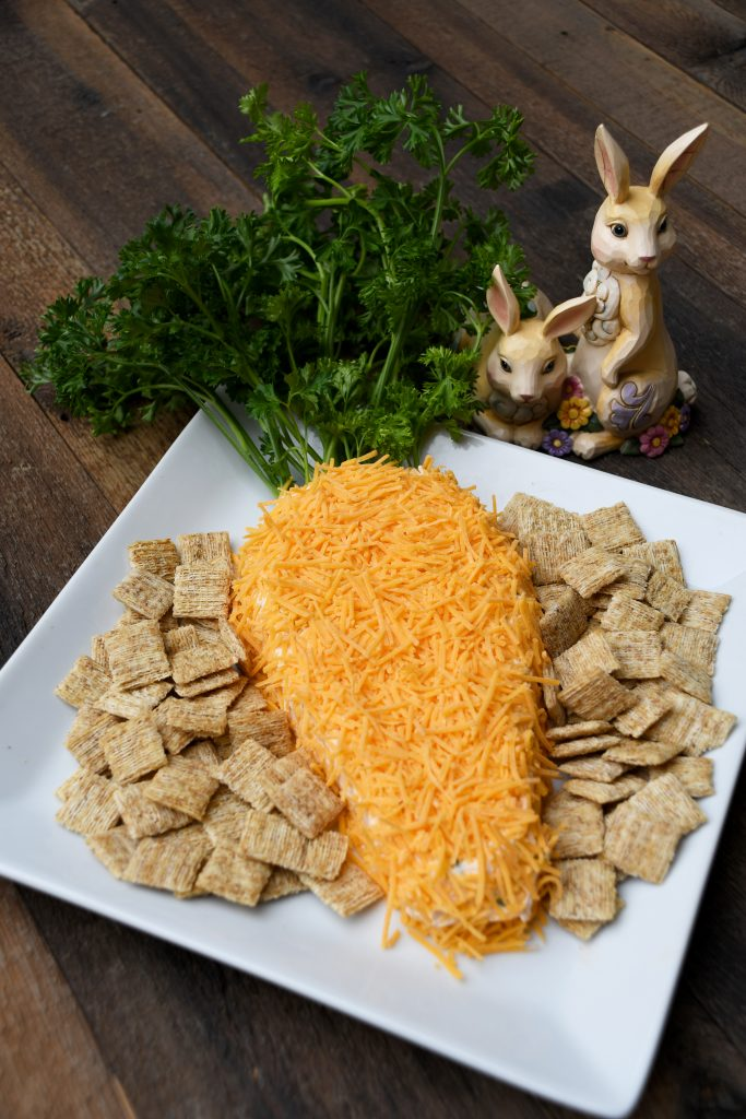 Carrot-Shaped Cheese Spread With Parsley Garnish And Jim Shore Figure