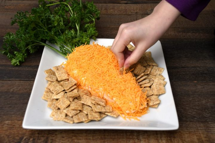 Dipping Into Cheese Spread With Mini Triscuit Cracker