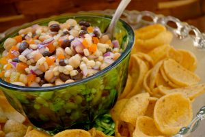 Colorful Cowboy Caviar Dip With Frito Scoops.