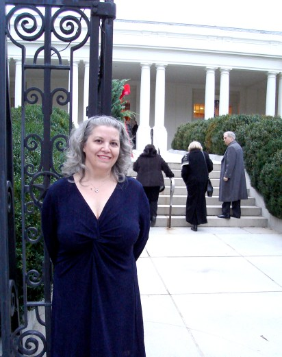 Connie Larsen, Bronner's ornament artist, at the entrance to the White House.
