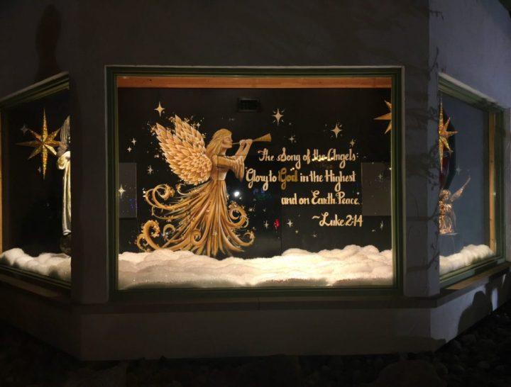 Bronner's Christmas Wonderland's Luke 2:14 Window Display Illuminated At Night In Frankenmuth, Michigan.
