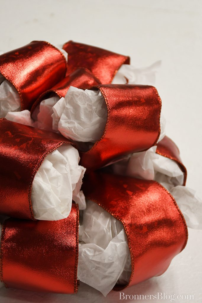 Help bows keep their shape by putting tissue paper in the loops.