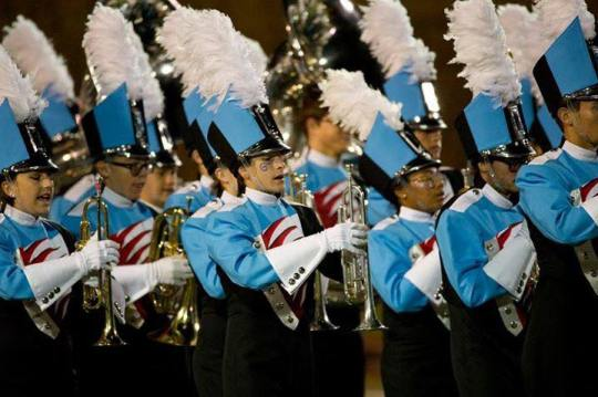 marching band in blue/black/white/red uniforms in McAllen, Christmas parades in Texas