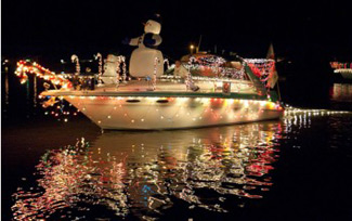 lighted & decorated boat on water off South Padre Island, Christmas parades in Texas