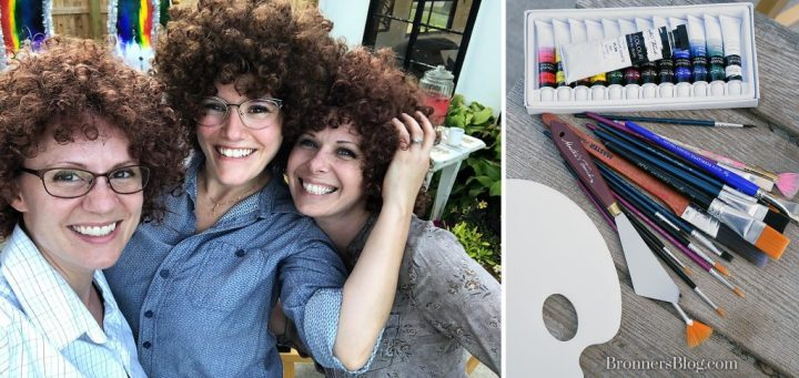 Bob Ross wigs and oil paints with paint brushes, palette knifes and painters palette make the Bob Ross painting party complete.