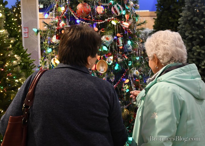 Ladies admiring nostalgic tinsel icicles on the tree at Bronner's