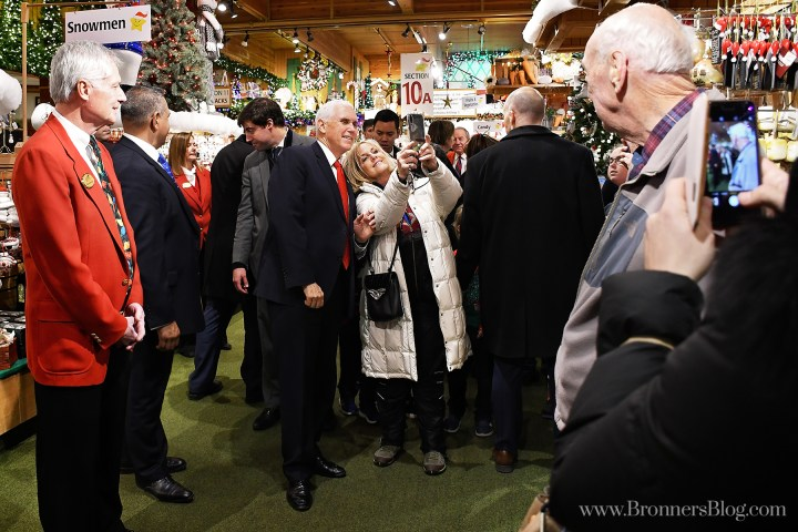 Vice President Mike Pence poses for a selfie with a guest  at Bronner's on his stop in Michigan.
