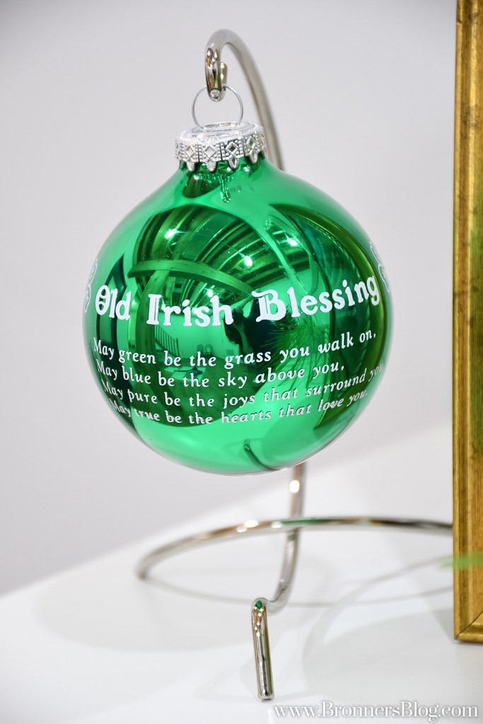 Shiny green Old Irish Blessing ornament hanging from a silver ornament stand