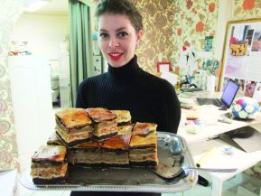 Raj Ráchel with her famous traditional Eastern European Jewish pastry, Flódnija.