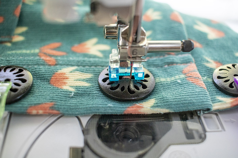 stitch button in place