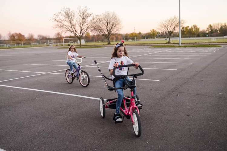 Skyler and Adrianna riding bikes